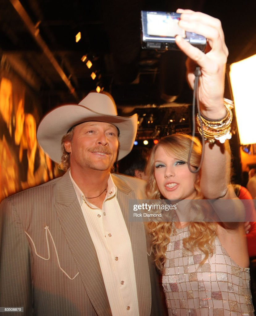 Alan Jackson being photographed by Taylor Swift backstage before the Taping of CMT 'GIANTS' Honoring Alan Jackson at The Ryman Auditorium on October 30, 2008 in Nashville, Tennessee. CMT 'GIANTS' airs December 6, 2008 at 9pm ET only on CMT.