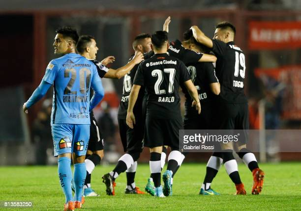 Alan Javier Franco of Independiente celebrates with teammates after scoring the first goal of his team during the first leg match between...
