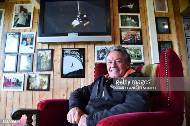 Alan John Hackett of New Zealand poses in front of pictures in a room at the Souleuvre Viaduct where he created his first spot on June 6 2017 in La...