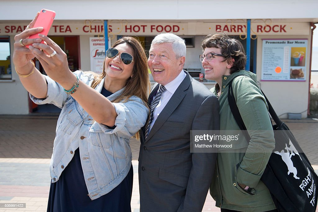 Alun Johnson (centre), Labour MP and former Home Secretary, poses for a picture during a visit to Barry with the the Labour IN for Britain campaign battle bus on May 31, 2016 in Barry, Wales. Britain will vote either to leave or remain in the EU in a referendum on June 23.