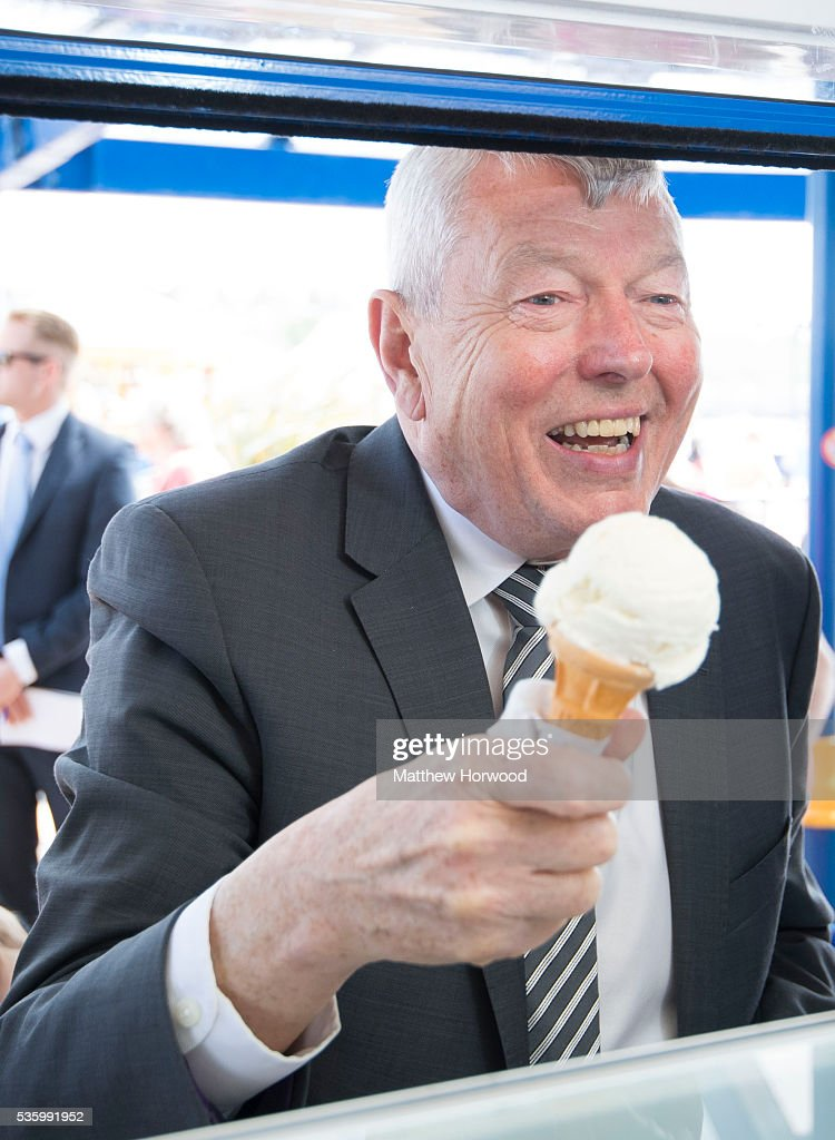 Alun Johnson, Labour MP and former Home Secretary, with an ice cream during a visit to Whitmore Bay in Barry on the the Labour IN for Britain campaign battle bus on May 31, 2016 in Barry, Wales. Britain will vote either to leave or remain in the EU in a referendum on June 23.