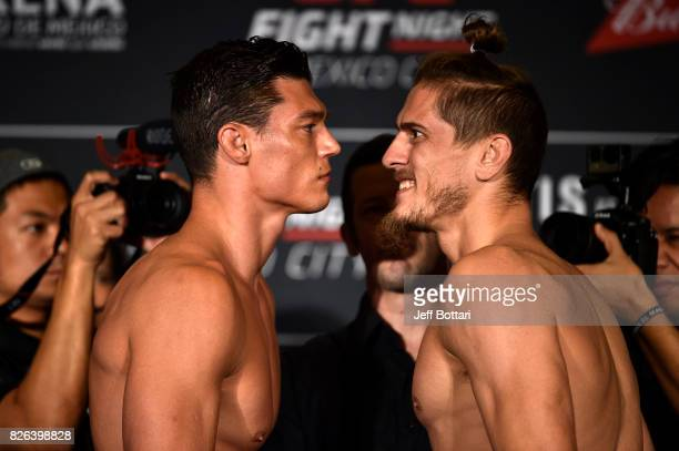 Alan Jouban of the United States and Niko Price of the United States face off during the UFC Fight Night weighin inside the W Hotel on August 4 2017...