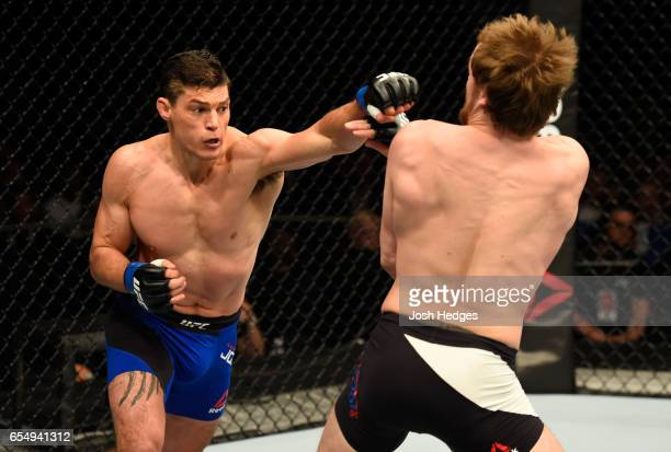 Alan Jouban of the United States punches Gunnar Nelson of Iceland in their welterweight fight during the UFC Fight Night event at The O2 arena on...