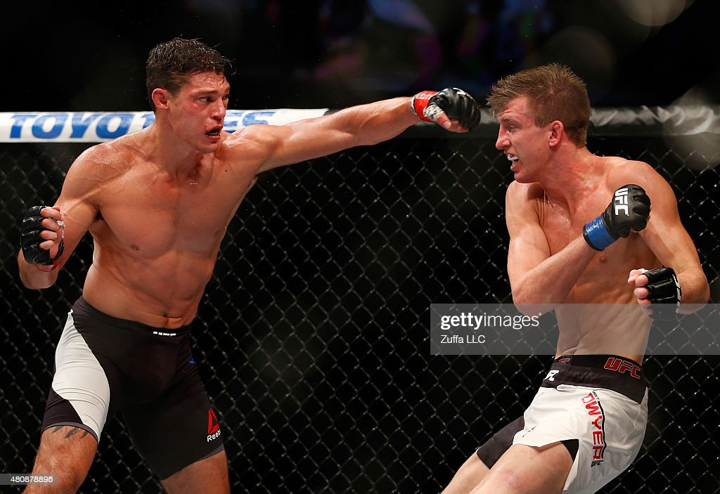 Alan Jouban punches Matt Dwyer of Canada in their welterweight bout during the UFC event at the Valley View Casino Center on July 15, 2015 in San Diego, California.