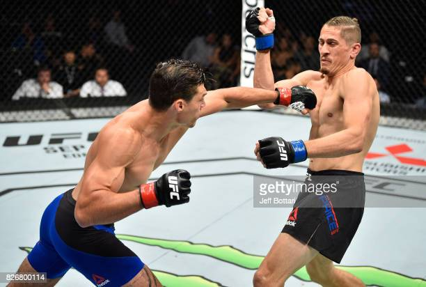 Alan Jouban punches Niko Price in their welterweight bout during the UFC Fight Night event at Arena Ciudad de Mexico on August 5 2017 in Mexico City...