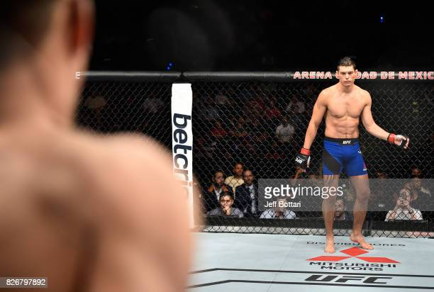 Alan Jouban stands across the Octagon from Niko Price in their welterweight bout during the UFC Fight Night event at Arena Ciudad de Mexico on August...