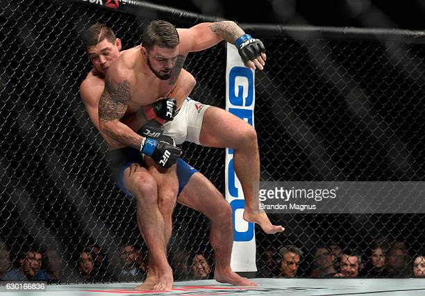 Alan Jouban takes down Mike Perry in their welterweight bout during the UFC Fight Night event inside the Golden 1 Center Arena on December 17 2016 in...
