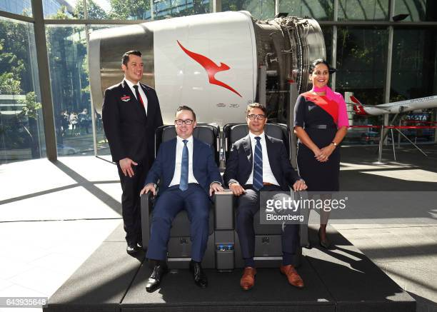 Alan Joyce chief executive officer of Qantas Airways Ltd front left and Tino La Spina chief financial officer of Qantas Airways Ltd front right pose...