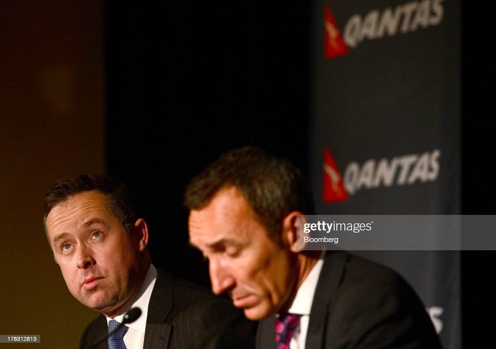 Alan Joyce, chief executive officer of Qantas Airways Ltd., left, and Gareth Evans, chief financial officer, attend a news conference in Sydney, Australia, on Thursday, Aug. 29, 2013. Qantas, Australia's largest carrier, doubled its profits and beat analyst estimates as a tie-up with Emirates helped rein in long-haul losses. Its shares rose the most in a year. Photographer: Jeremy Piper/Bloomberg via Getty Images