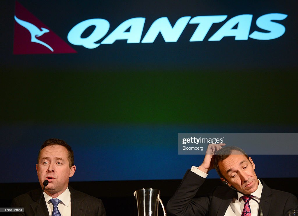 Alan Joyce, chief executive officer of Qantas Airways Ltd., left, speaks as Gareth Evans, chief financial officer, looks on during a news conference in Sydney, Australia, on Thursday, Aug. 29, 2013. Qantas, Australia's largest carrier, doubled its profits and beat analyst estimates as a tie-up with Emirates helped rein in long-haul losses. Its shares rose the most in a year. Photographer: Jeremy Piper/Bloomberg via Getty Images