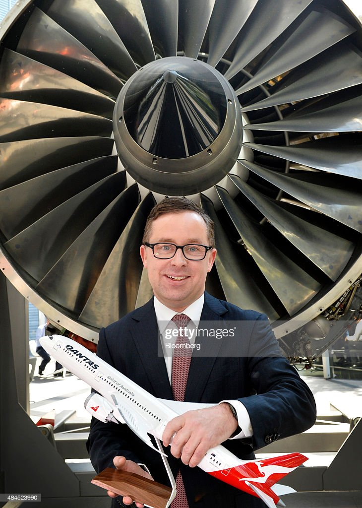 Alan Joyce, chief executive officer of Qantas Airways Ltd., poses for a photograph with a model of an aircraft following a news conference in Sydney, Australia, on Thursday, Aug. 20, 2015. Qantas said it would buy eight Boeing Co. Dreamliners and return A$505 million ($371 million) to shareholders as it posted its strongest full-year earnings since Joyce took the helm in 2008. Photographer: Jeremy Piper/Bloomberg via Getty Images