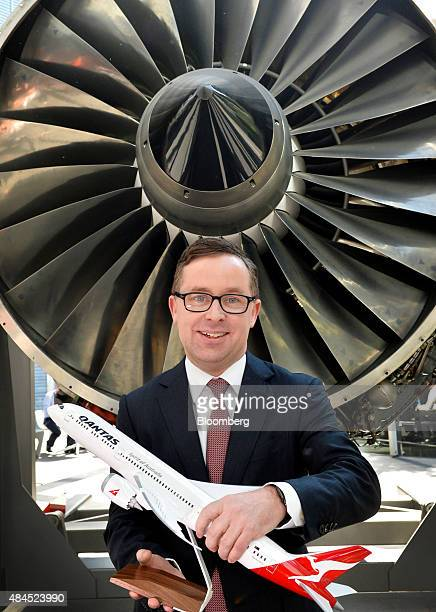 Alan Joyce chief executive officer of Qantas Airways Ltd poses for a photograph with a model of an aircraft following a news conference in Sydney...