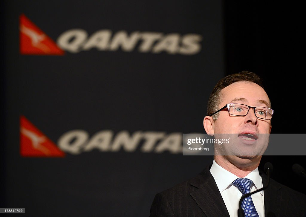 Alan Joyce, chief executive officer of Qantas Airways Ltd., speaks during a news conference in Sydney, Australia, on Thursday, Aug. 29, 2013. Qantas, Australia's largest carrier, doubled its profits and beat analyst estimates as a tie-up with Emirates helped rein in long-haul losses. Its shares rose the most in a year. Photographer: Jeremy Piper/Bloomberg via Getty Images