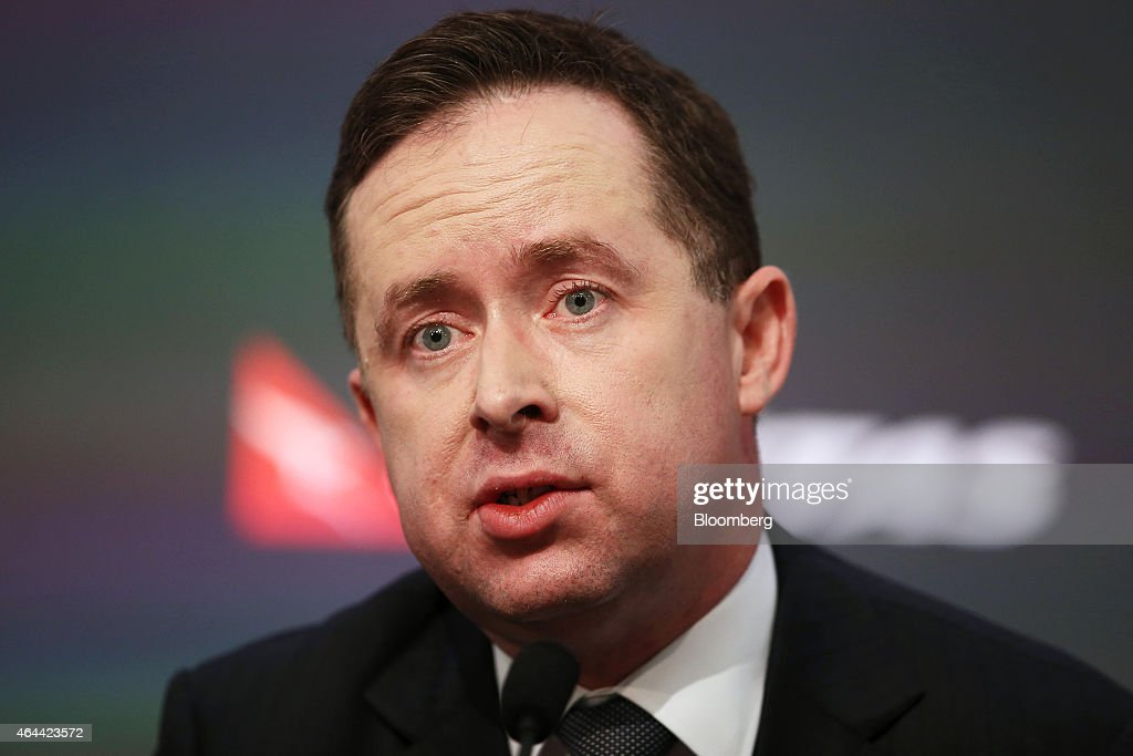 Alan Joyce, chief executive officer of Qantas Airways Ltd., speaks during a news conference in Sydney, Australia, on Thursday, Feb. 26, 2015. Qantas posted its strongest half-year earnings in four years, as Joyce's cost-cutting turnaround plan helps Australia's biggest carrier rebound from a record loss. Photographer: Brendon Thorne/Bloomberg via Getty Images