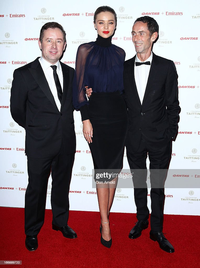 Alan Joyce, <a gi-track='captionPersonalityLinkClicked' href=/galleries/search?phrase=Miranda+Kerr&family=editorial&specificpeople=5714330 ng-click='$event.stopPropagation()'>Miranda Kerr</a> and Martin Grant attend the QANTAS Gala Dinner at Sydney Domestic Airport on April 18, 2013 in Sydney, Australia.