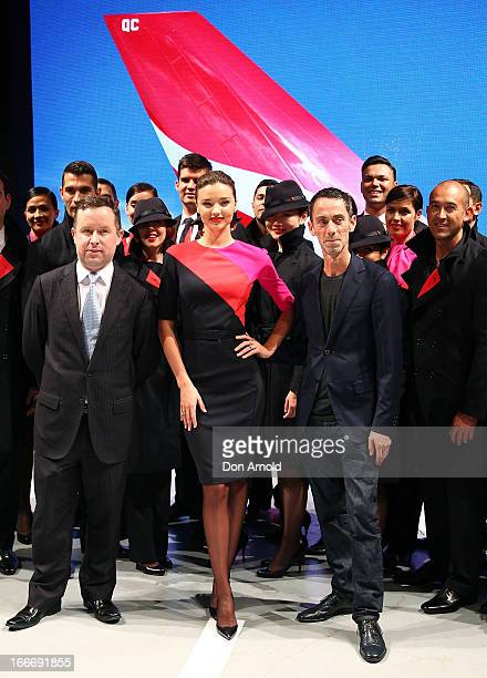 Alan Joyce Miranda Kerr and Martin Grant pose alongside Qantas staff during the Qantas uniform unveiling at Hordern Pavilion on April 16 2013 in...