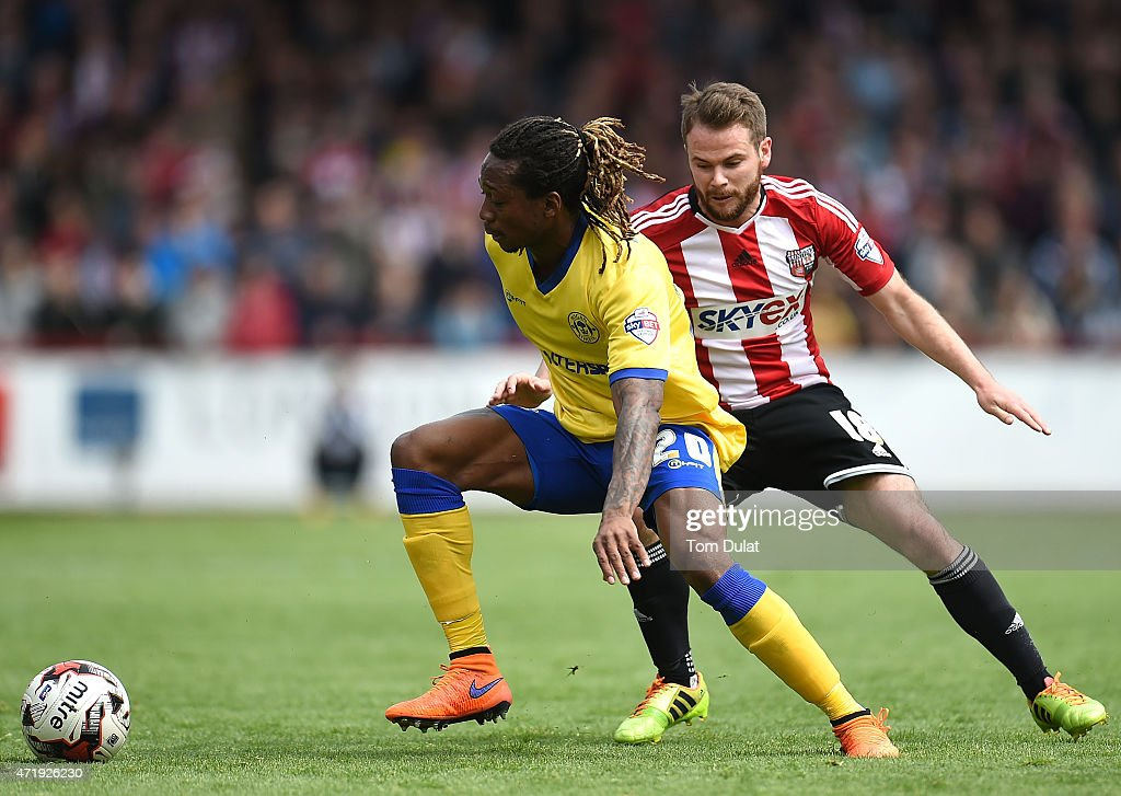 Alan Judge of Brentford and Gaetan Bong of Wigan Athletic in action during the Sky Bet Championship match between Brentford and Wigan Athletic at Griffin Park on May 2, 2015 in Brentford, England.