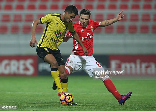 Alan Junior of AD Fafe challenges Pedro Amaral of SL Benfica B during the Segunda Liga match between SL Benfica B and AD Fafe at Caixa Futebol Campus...