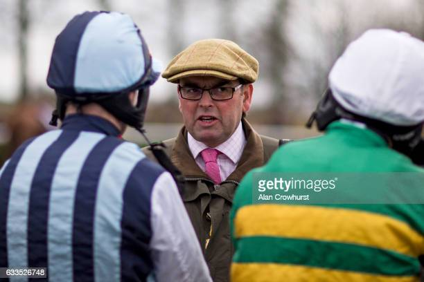 Alan King chats with his jockeys at Wincanton Racecourse on February 2 2017 in Wincanton England