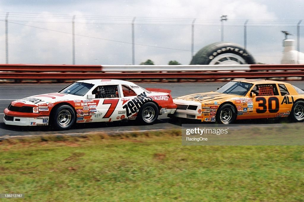 Alan Kulwicki (No. 7) leads <a gi-track='captionPersonalityLinkClicked' href=/galleries/search?phrase=Michael+Waltrip&family=editorial&specificpeople=204621 ng-click='$event.stopPropagation()'>Michael Waltrip</a> in the Wrangler Jeans Indigo 400 at Richmond Fairgrounds Raceway. The pair finished 23rd and 19th, respectively.