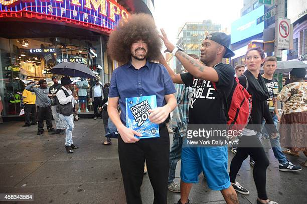 Alan Labbe who holds the Guinness World Record for the world's largest male afro strolls Times Square Labbe began growing his afro four years ago...