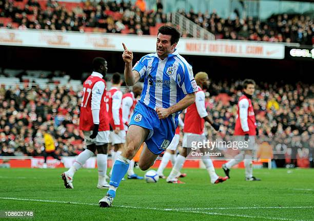 Alan Lee of Huddersfield celebrates after levelling the scores at 11 during the FA Cup sponsored by EON fourth round match between Arsenal and...