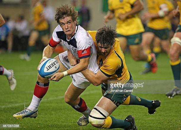 Alan Macginty of the United States Eagles looks to pass as he is hit by Sam Carter of the Australia Wallabies during a match at Soldier Field on...