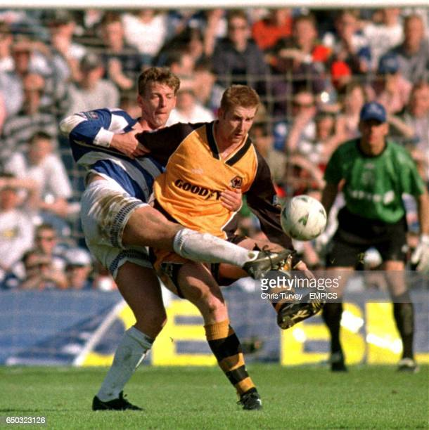 Alan McDonald of QPR and Wolves' Iwan Roberts tussle for the ball