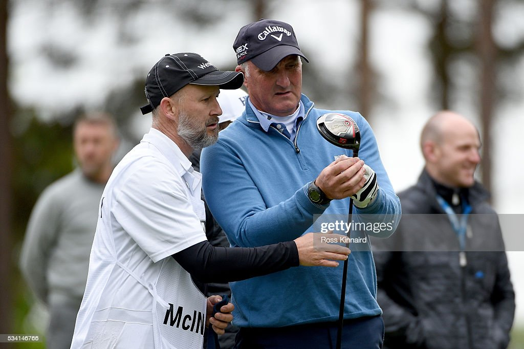 Alan McInally checks his driver during the Pro-Am prior to the BMW PGA Championship at Wentworth on May 25, 2016 in Virginia Water, England.
