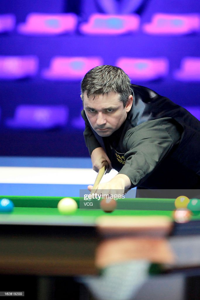 Alan McManus of Scotland plays a shot during the match against John Higgins of Scotland on day three of the 2013 World Snooker Haikou Open at Haikou Convention and Exhibition Center on February 27, 2013 in Haikou, China.
