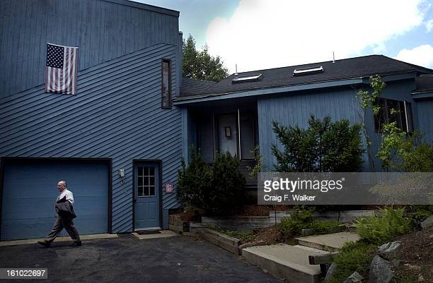 JULY 19 2004 Alan McWilliams leaves for a job fair from his Holliston home Alan and his family have lived in the house that Alan designed and built...