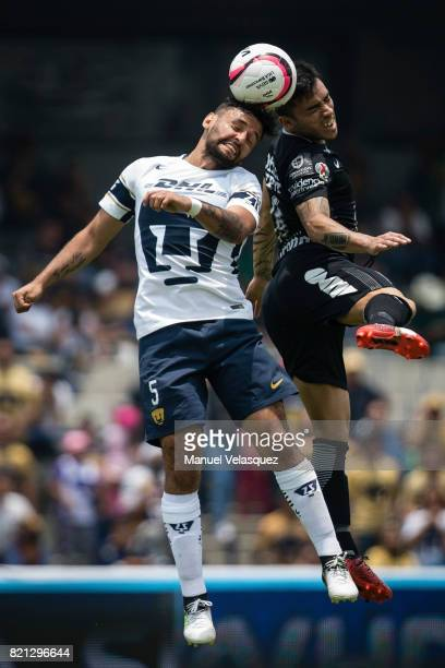 Alan Mendoza of Pumas struggles for the ball with Edson Puch of Pachuca during the 1st round match between Pumas UNAM and Pachuca as part of the...