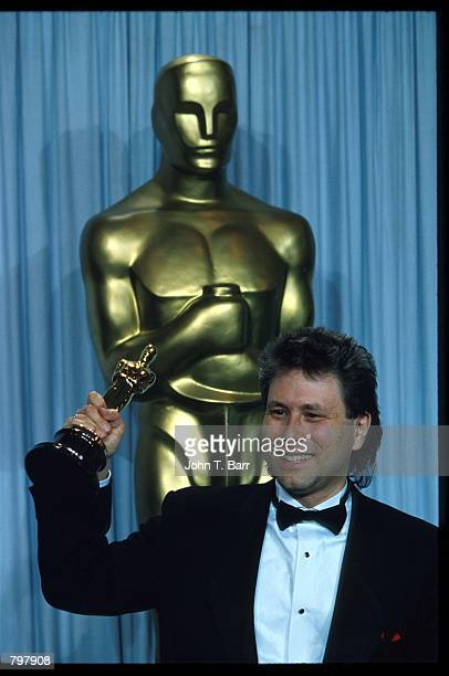 Alan Menken stands backstage during the 62nd Academy Awards ceremony March 26 1990 in Los Angeles CA Menken received an Oscar for Best Original Score...
