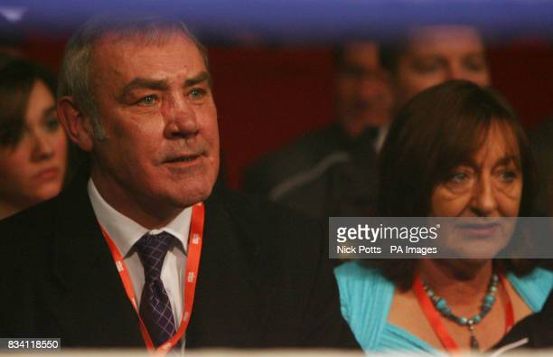 Alan Minter and his wife watch their son Ross Minter in action during the WBU Welterweight Title bout at Excel Arena London