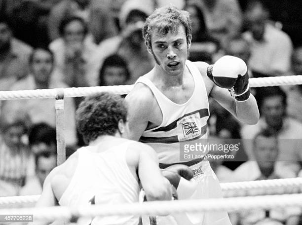 Alan Minter of Great Britain eventual bronze medallist en route to defeating Loucif Hanamani of Algeria during their light middleweight boxing match...
