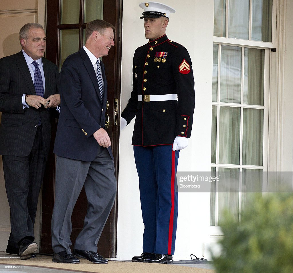 Alan Mulally, center, chief executive officer of Ford Motor Co., and Mark T. Bertolini, chairman, chief executive officer and president of Aetna Inc., depart from the West Wing of the White House after meeting with U.S. President Barack Obama in Washington, D.C., U.S., on Wednesday, Nov. 14, 2012. Obama met with a dozen corporate leaders at the White House today in his latest overture to the business community as he works to build support for a debt deal that includes new taxes on wealthy Americans. Photographer: Joshua Roberts/Bloomberg via Getty Images