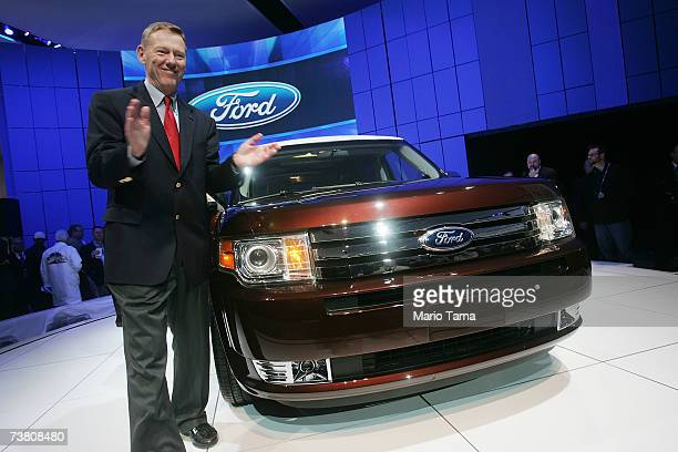 Alan Mulally President and CEO of Ford Motor Company poses after introducing the new Ford Flex after it was unveiled at the New York International...