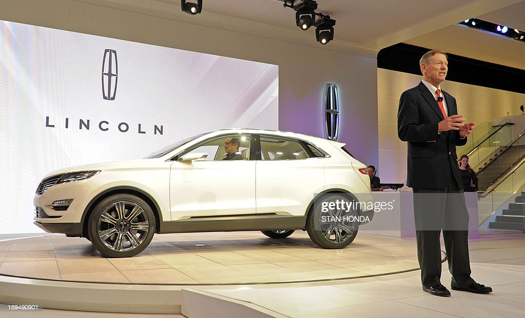 Alan Mulally, President and Chief Executive Officer for Ford, speaks to the audience as the 2014 Lincoln MKC Concept cross-over SUV is introduced at the 2013 North American International Auto Show in Detroit, Michigan, January 14, 2013. AFP PHOTO/Stan HONDA