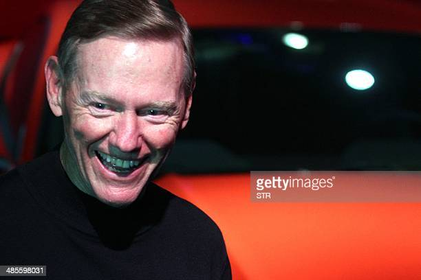 Alan Mulally president and chief executive officer of Ford Motor Company poses for a photo at the 50 years celebration ceremony for the Ford Mustang...
