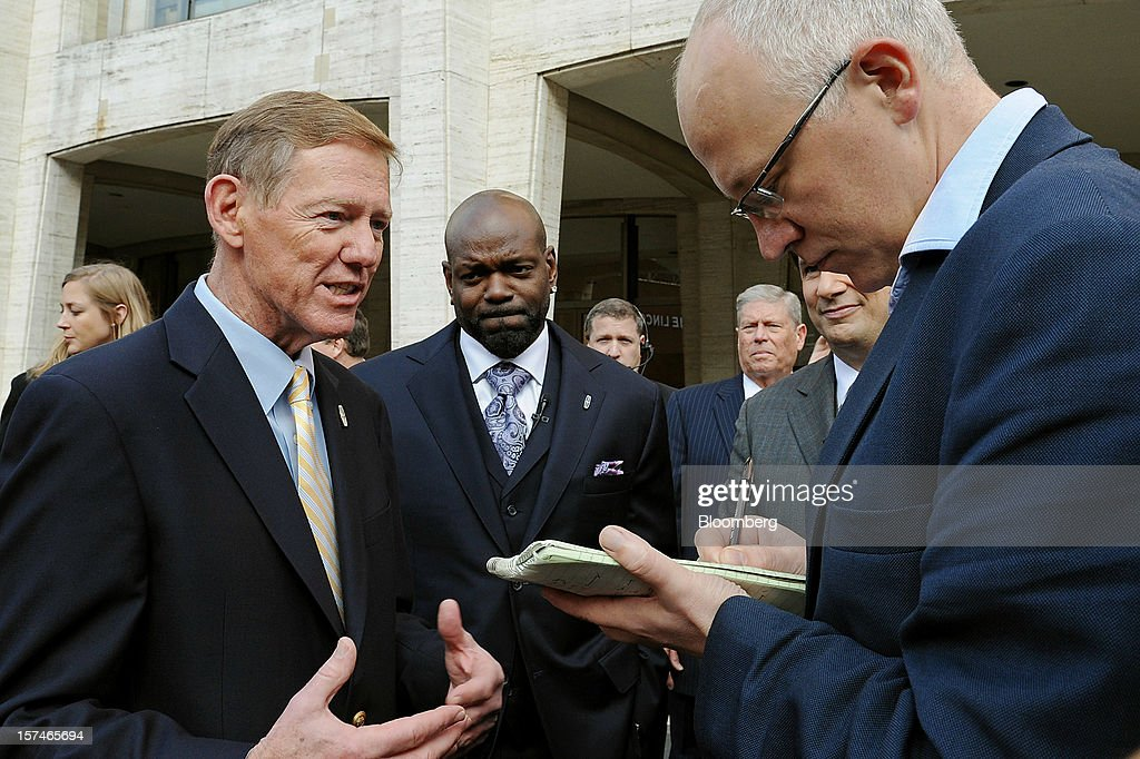 Alan Mulally, president and chief executive officer of Ford Motor Co., left, speaks to the media as former professional football player Emmitt Smith, center, looks on during the unveiling of the Lincoln MKZ vehicle in New York, U.S., on Monday, Dec. 3, 2012. Ford Motor Co., seeking to revive sales of Lincoln vehicles, is fielding the brand's first Super Bowl spot as well as a television commercial that portrays the U.S. president who gave the luxury line its name. Photographer: Peter Foley/Bloomberg via Getty Images