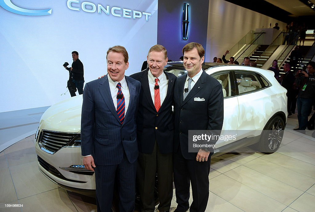 Alan Mulally, president and chief executive officer of Ford Motor Co., center, Bill Ford, executive chairman of Ford Motor Co., left, and Jim Farley, group vice president of global marketing, sales and service for Ford Motor Co., stand for a photograph during the unveiling of the Lincoln MKC concept vehicle at the 2013 North American International Auto Show (NAIAS) in Detroit, Michigan, U.S., on Monday, Jan. 14, 2013. Ford Motor Co. is considering modifying Lincoln models before they go on sale in China next year to meet the tastes of consumers there who often expect to be chauffeur-driven in their luxury cars. Photographer: Daniel Acker/Bloomberg via Getty Images