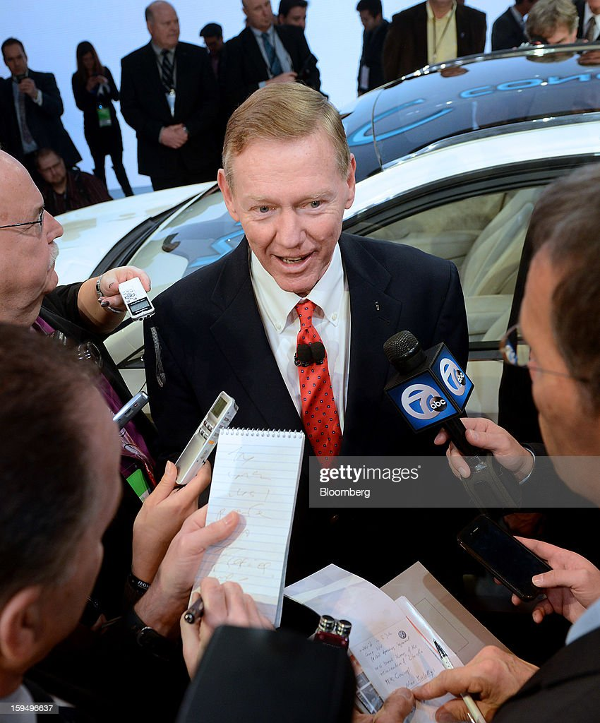 Alan Mulally, president and chief executive officer of Ford Motor Co., center, speaks to the press during the unveiling of the Lincoln MKC concept crossover vehicle at the 2013 North American International Auto Show (NAIAS) in Detroit, Michigan, U.S., on Monday, Jan. 14, 2013. Ford Motor Co. is considering modifying Lincoln models before they go on sale in China next year to meet the tastes of consumers there who often expect to be chauffeur-driven in their luxury cars. Photographer: Daniel Acker/Bloomberg via Getty Images