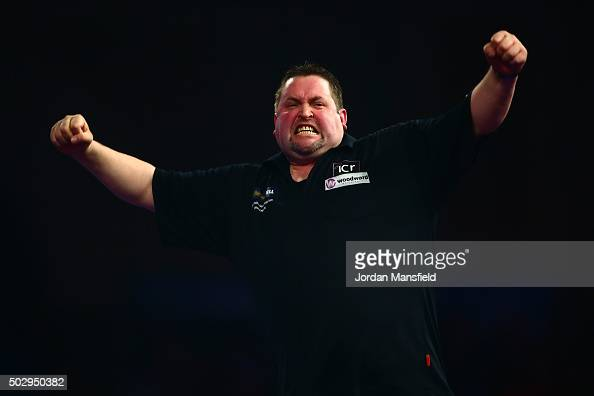 Alan Norris of England celebrates winning his third round match against Mark Webster of Wales on Day Twelve of the 2016 William Hill PDC World Darts...