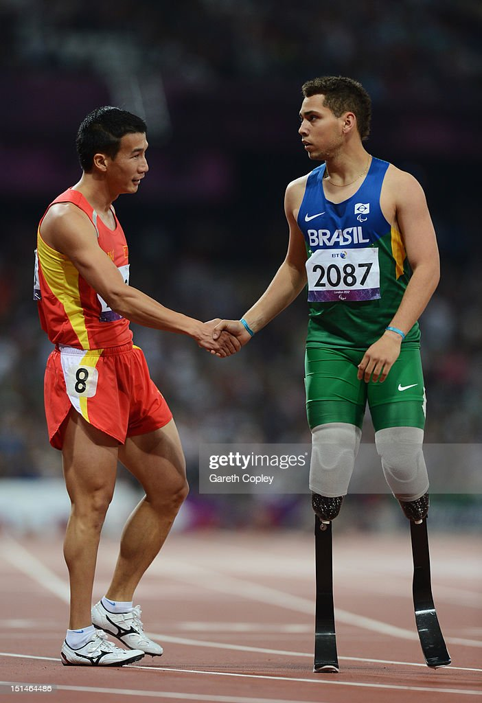 Alan Fonteles Cardoso Oliveira of Brazil shakes hands with Zhiming Liu of China after the Men's 400m T44 heats on day 9 of the London 2012 Paralympic Games at Olympic Stadium on September 7, 2012 in London, England.
