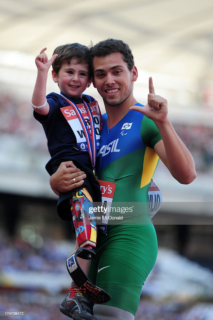 Alan Oliveira of Brazil poses with 5 year old Rio Woolf after winning the Men's T43/44 100mduring day three of the Sainsbury's Anniversary Games - IAAF Diamond League 2013 at The Queen Elizabeth Olympic Park on July 28, 2013 in London, England.