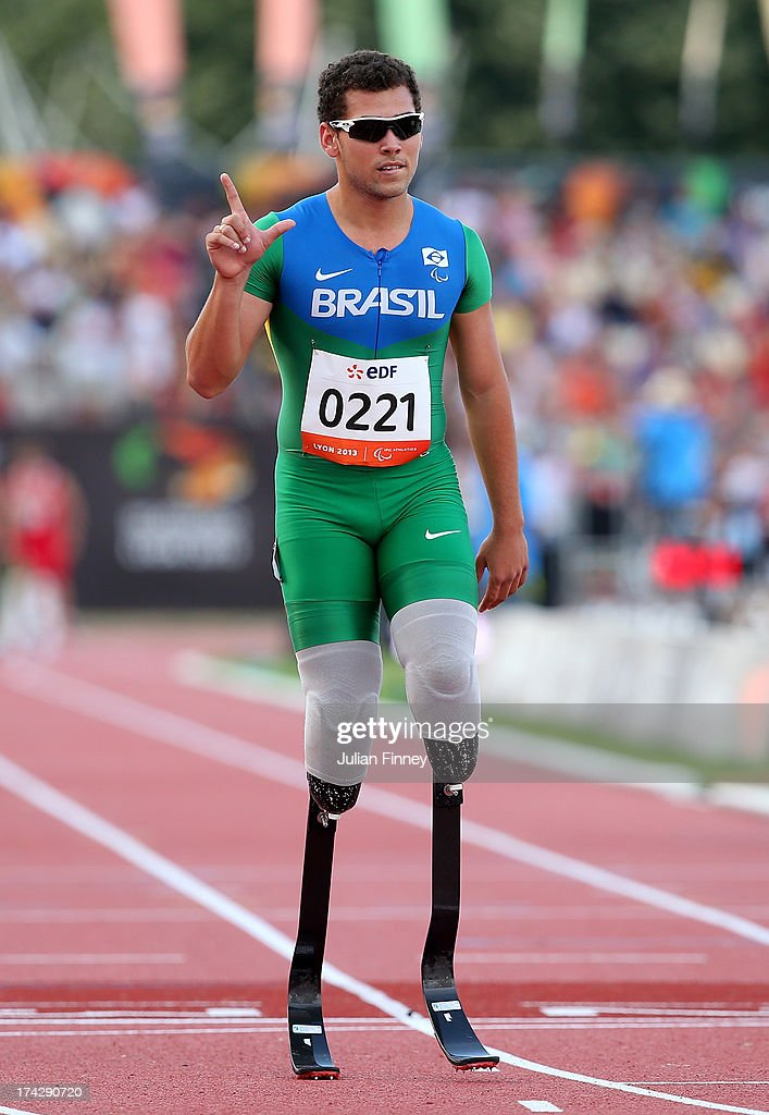 Alan Fonteles Oliveira of Brazil celebrates winning the Men's 100m T43 final during day four of the IPC Athletics World Championships on July 23, 2013 in Lyon, France.