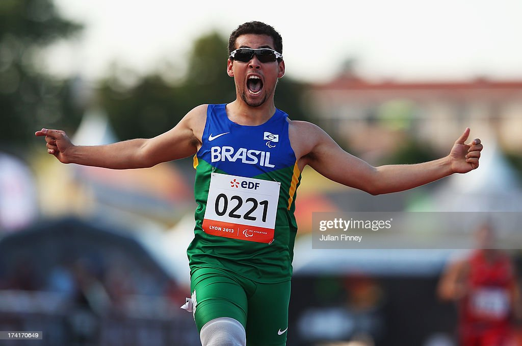 Alan Fonteles Oliveira of Brazil celebrates winning the Men's 200m T43 final during day two of the IPC Athletics World Championships on July 21, 2013 in Lyon, France.