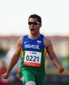 Alan Fonteles Oliveira of Brazil celebrates winning the Men's 200m T43 final during day two of the IPC Athletics World Championships on July 21 2013...