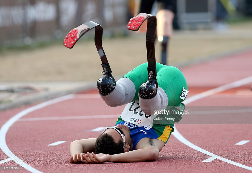 Alan Fonteles Oliveira of Brazil falls over after his win in the Men's 400m T44 final during day seven of the IPC Athletics World Championships on July 26, 2013 in Lyon, France.
