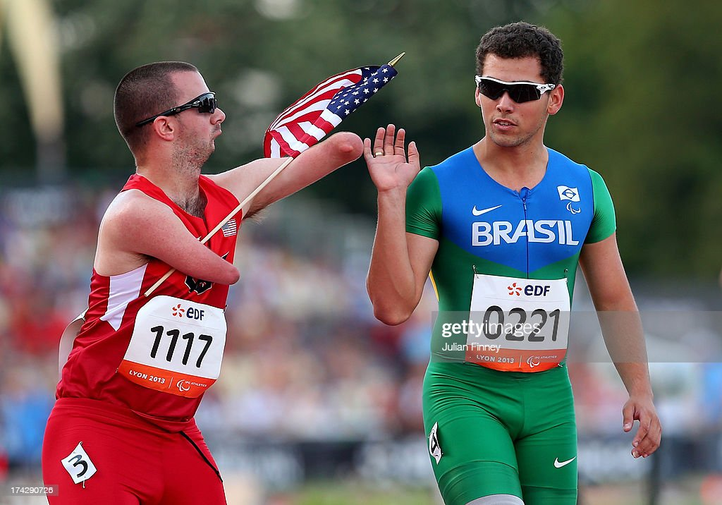 Alan Fonteles Oliveira of Brazil is congratulated by Joshua Kennison of USA after he won the Men's 100m T43 final during day four of the IPC Athletics World Championships on July 23, 2013 in Lyon, France.